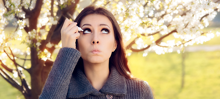 Woman with Spring Eye Allergies Using Eye Drops